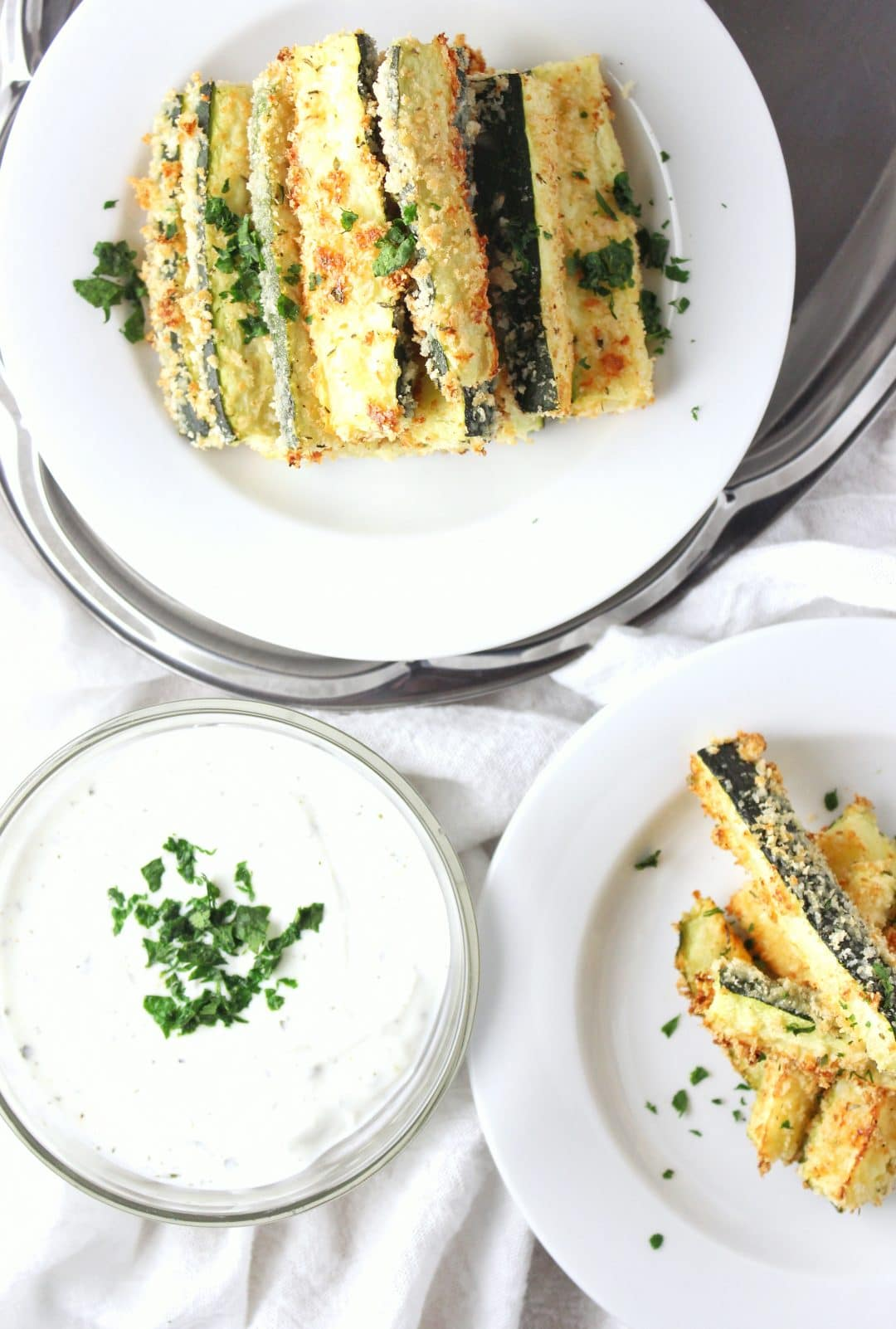 Baked Zucchini Fries - a crispy, tender, and healthy alternative to fried potato fries. This recipe is so easy to make and pair with any meal. simplylakita.com #healthyrecipe #zucchini