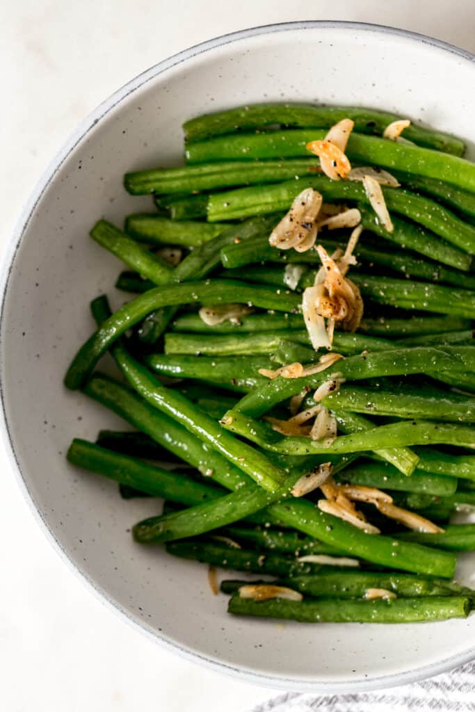 garlic green beans in a bowl with a napkin
