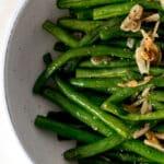 overhead view garlic green beans in a bowl