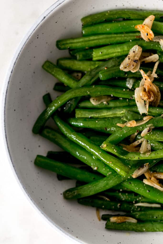 overhead view garlic green beans in a bowl