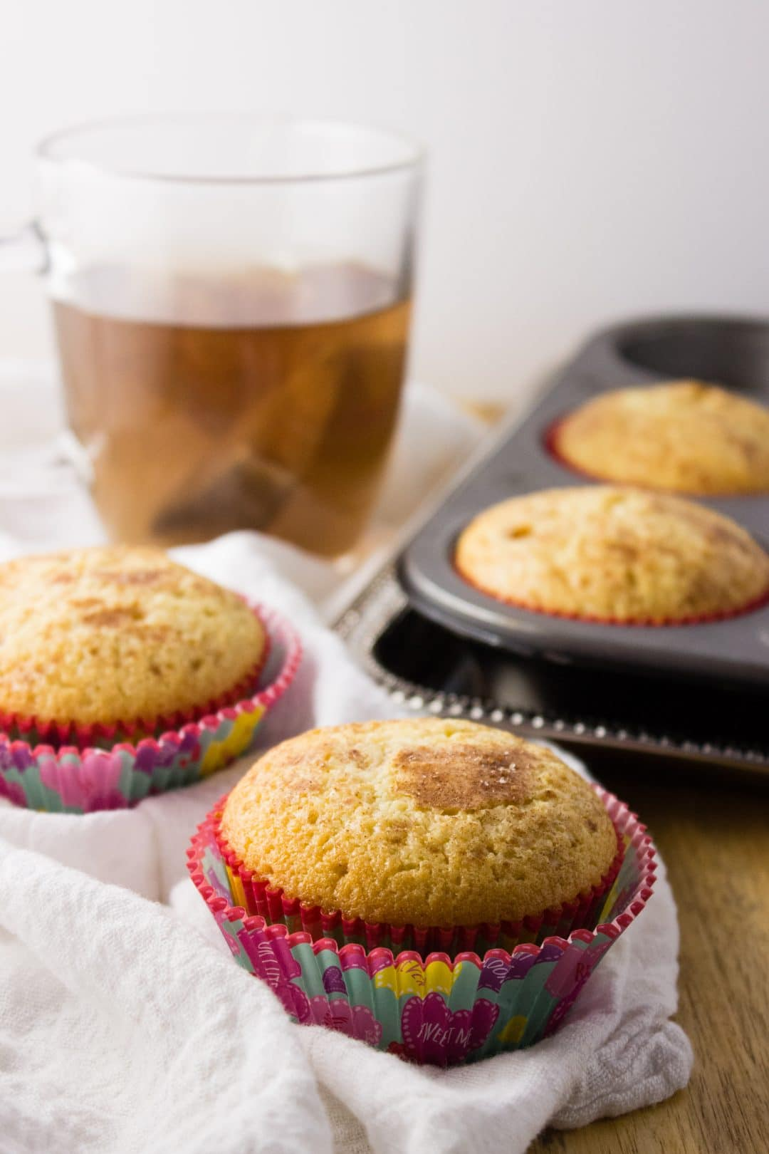 Coffee Cake Muffins - This small batch of muffins transforms classic coffee cake with a cinnamon streusel topping in the center for the perfect treat. simplylakita.com #muffins