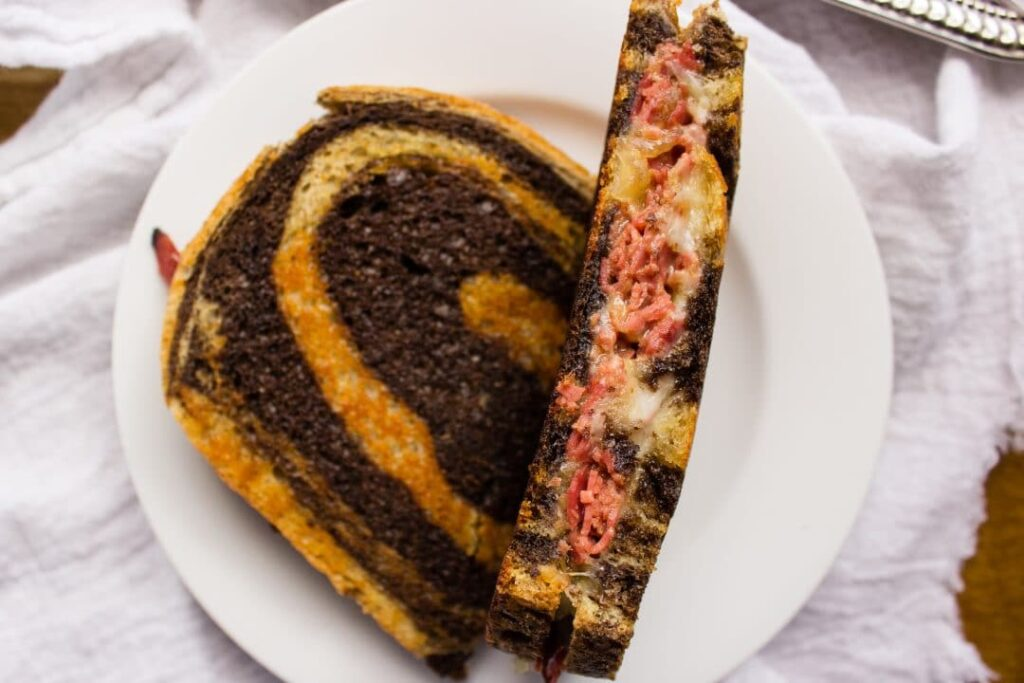Corned Beef Grilled Cheese - The ultimate St. Patrick's Day sandwich with buttery toasted bread, caramelized onions, melted cheese, and corned beef. simplylakita.com #stpatricksday