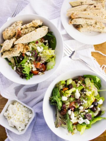 Greek Chicken Salad - marinated chicken turns this into a hearty dinner salad with mixed greens, tomatoes, olives, peppers, cucumbers, onion, and feta cheese. simplylakita.com #healthy #salad