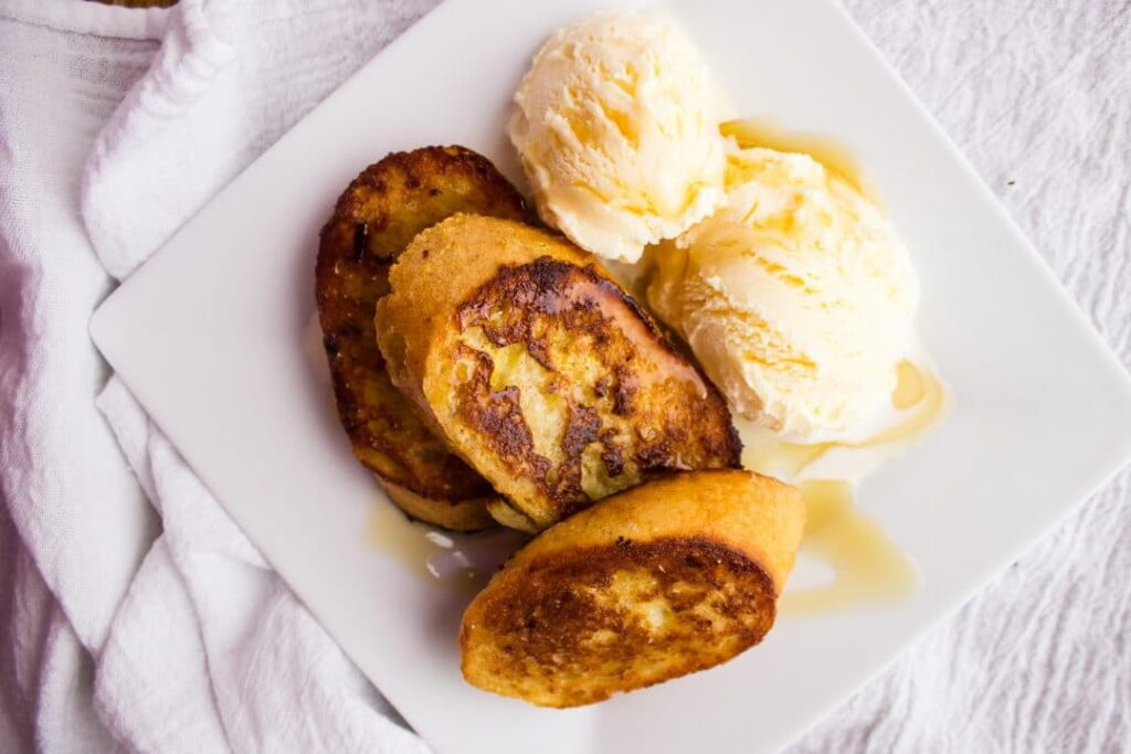 Rum French Toast - French toast made with rum and topped with a maple rum syrup. Your new favorite dessert once topped with your favorite ice cream. simplylakita.com #frenchtoast