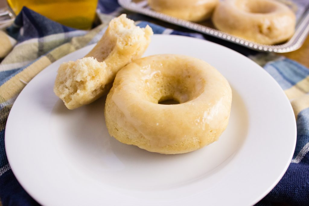 These Vegan Vanilla Donuts are so light, fluffy, and easy to make. Be sure to give them a try with a hot cup of coffee. Perfect for any time of day. simplylakita.com #vegan #donuts