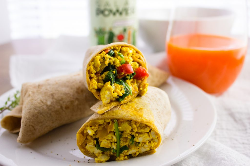 Tofu Scramble Recipe - Quick and Easy egg substitute for vegans that can be enjoyed as is or rolled into a flour tortilla for a delicious breakfast burrito. simplylakita.com #vegan #tofu