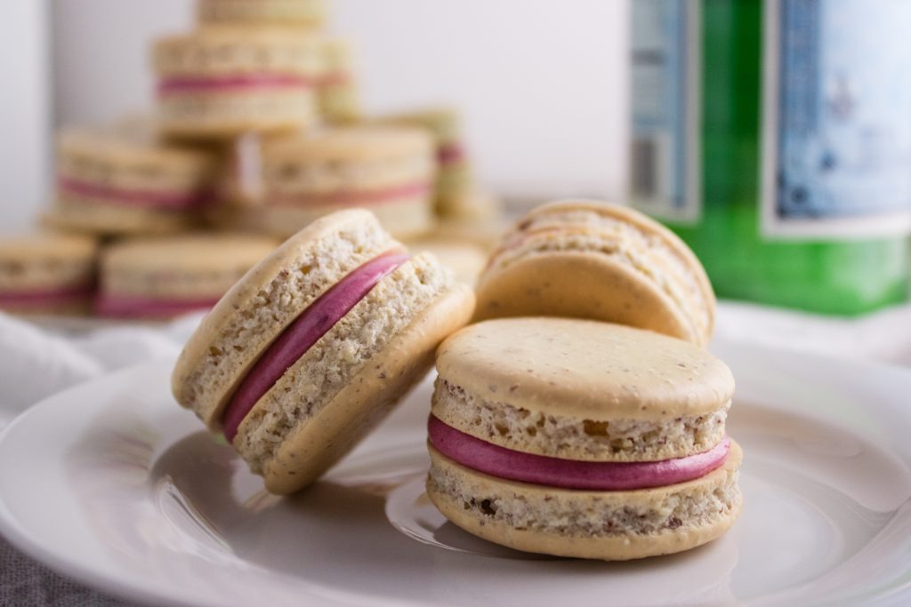 Blackberry Macarons - These classic macarons are filled with a delicious blackberry butter cream filling. The perfect treat for any occasion. simplylakita.com #macarons #blackberry
