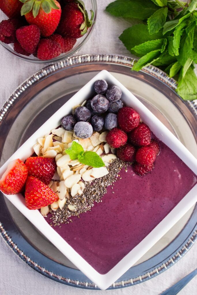 overhead view bright berry acai smoothie bowl