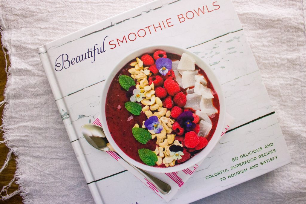 overhead view of cookbook the Bright Berry Acai Smoothie Bowl was in