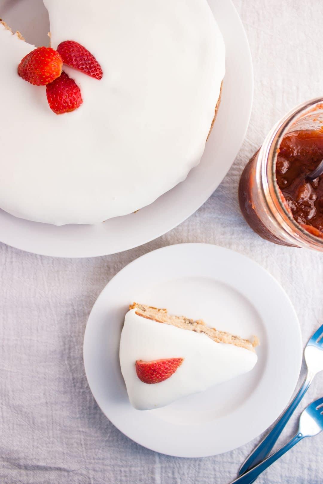 Strawberry Preserves Cake - Easy to make cake that incorporates strawberry preserves and is topped with a delicious lemon glaze. simplylakita.com #cake #strawberrypreserves