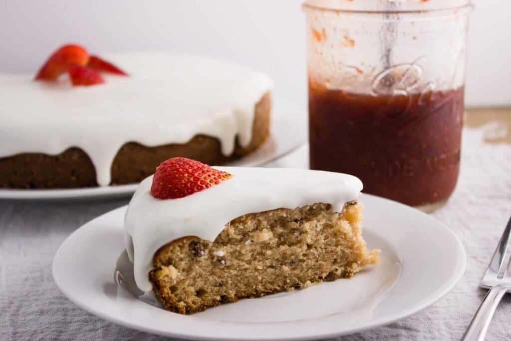 Strawberry Preserves Cake - Easy to make cake that incorporates strawberry preserves and is topped with a delicious lemon glaze. simplylakita.com #cake #strawberrypreserves