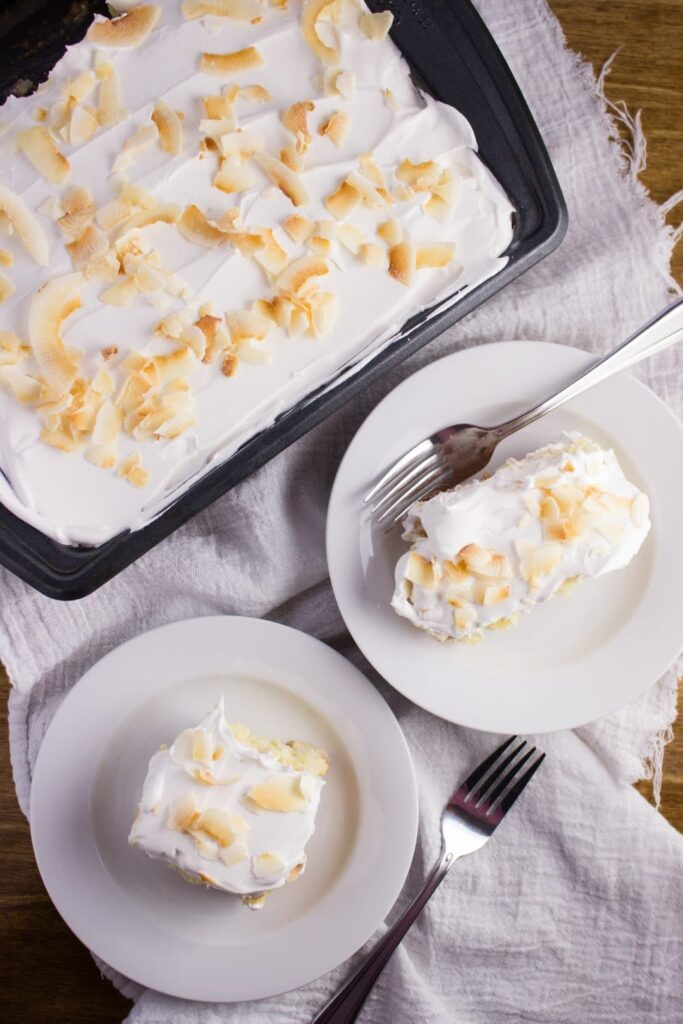 Tres Leches Cake Recipe - So easy and delicious! A simple cake that is soaked in a three full flavored milk mixture and topped with whipped cream. simplylakita.com #cincodemayo #treslechescake