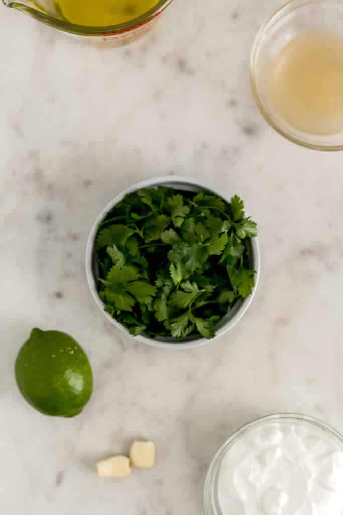 ingredients for cilantro lime dressing in small bowls
