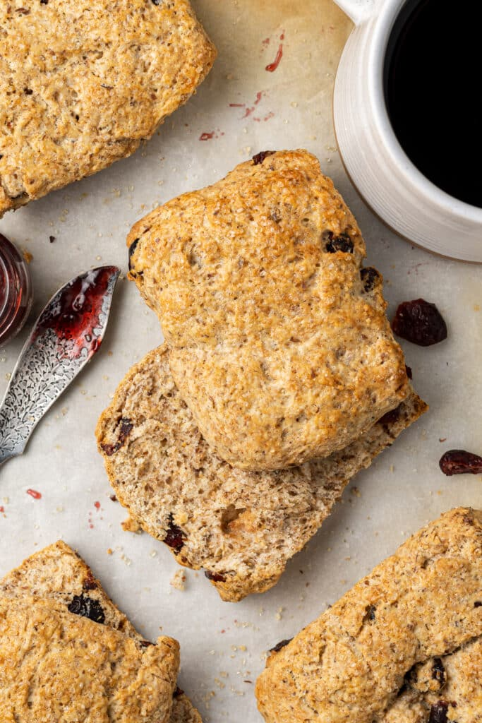 flaxseed scone on parchment paper cut in half with jam