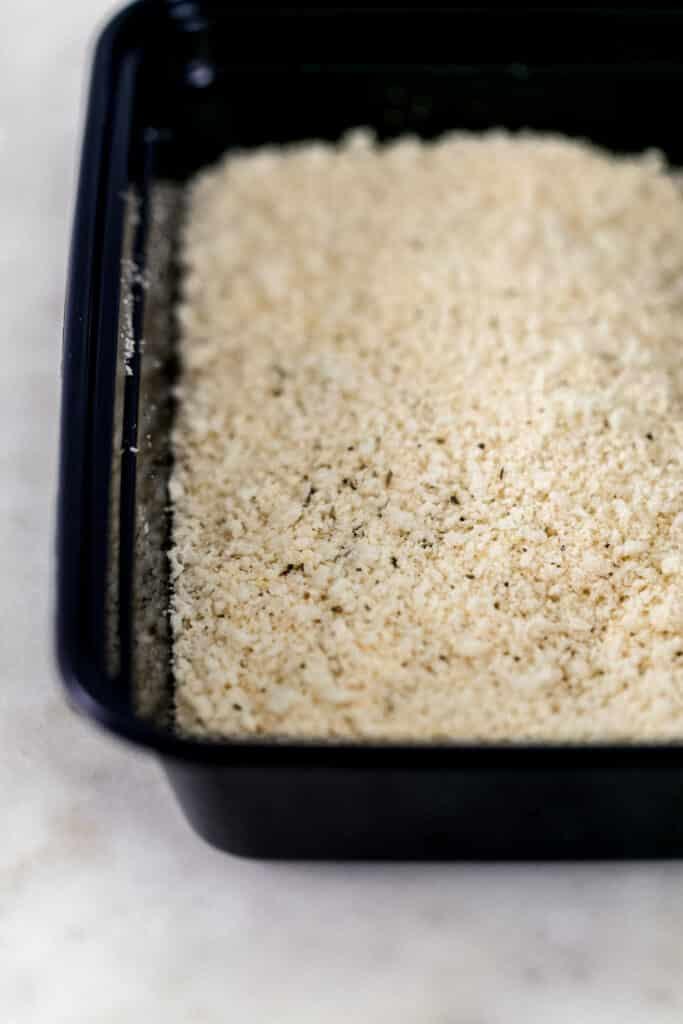 breadcrumb mixture in black plastic container
