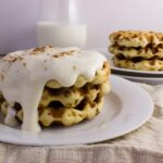 Cinnamon Roll Waffles - Get the delicious taste of cinnamon rolls in the form of a waffle topped with a cream cheese icing. So easy and delicious! simplylakita.com #breakfast #cinnamonroll #waffles