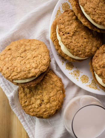 Oatmeal Cream Pies - The perfect homemade version of a classic childhood treat. Two soft oatmeal cookies sandwiched together with sweet buttery cream. simplylakita.com #dessert #oatmeal #snack