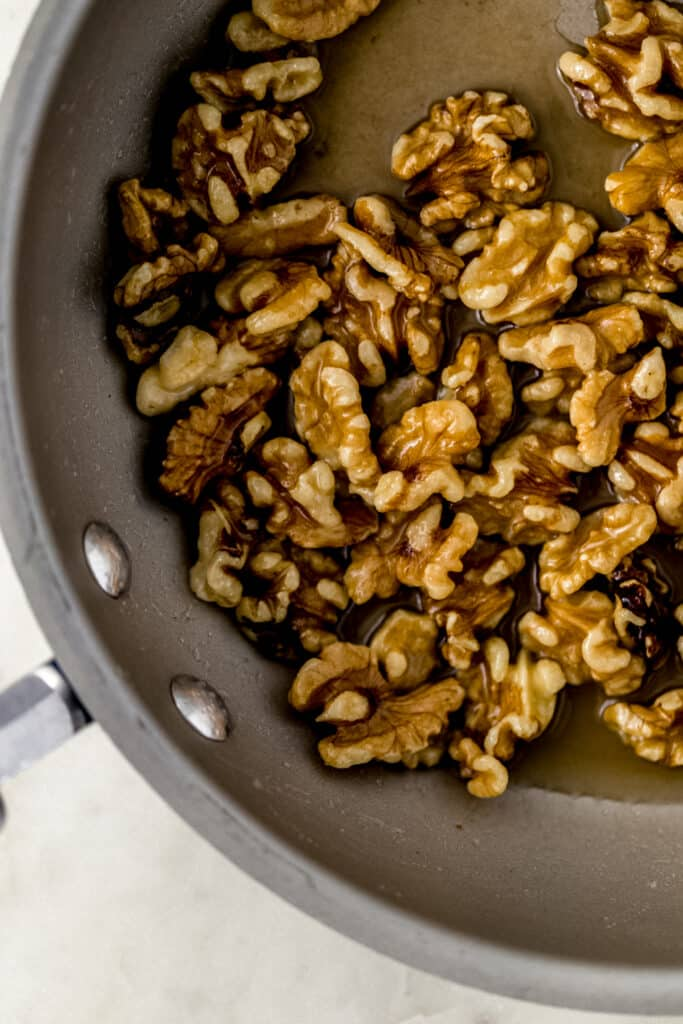 walnuts, butter, sugar, and water in skillet