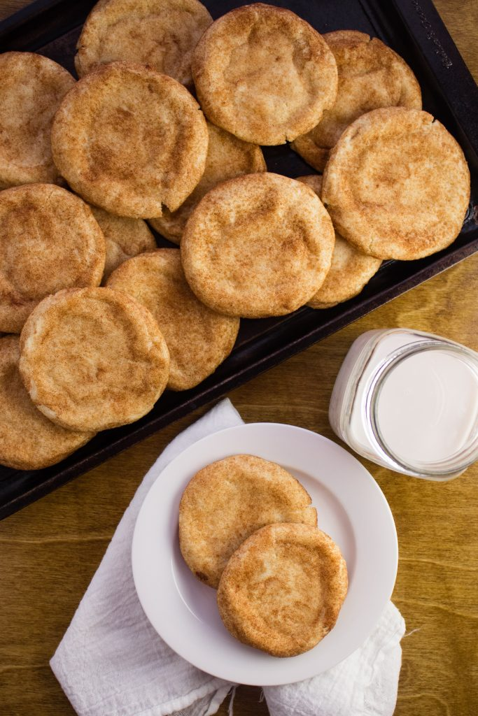 Snickerdoodle Cookies - A buttery sugar cookie rolled in a sweet cinnamon sugar mixture to form the most chewy and delicious cookie. simplylakita.com #cookies #snickerdoodles