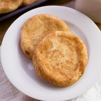two snickerdoodle cookies on a white plate