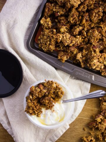 Pumpkin Spice Granola - Sweet granola infused with the flavors of Fall with the addition of pumpkin puree, maple syrup, and pumpkin pie spice. Simple, fast, and delicious! simplylakita.com #granola #pumpkinspice