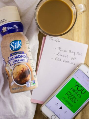 silk coffee creamer next to cell phone and notepad with to do list