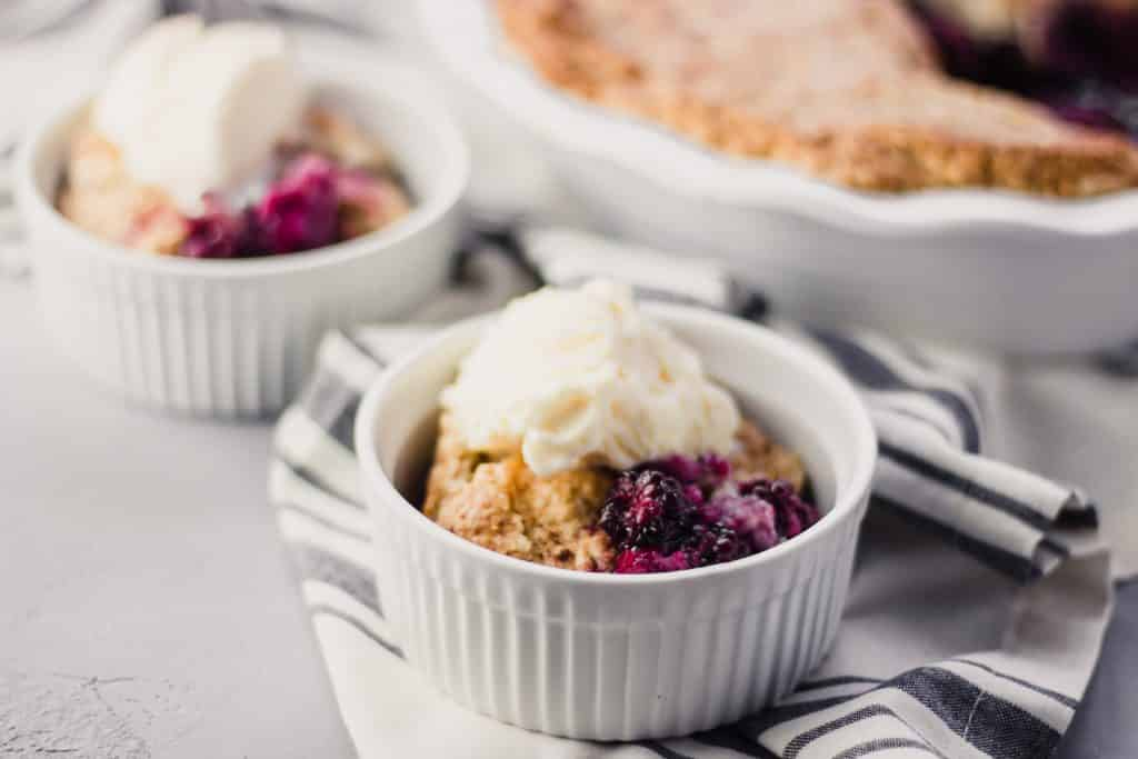 close-up side view of Blackberry Cobbler in bowl over napkin