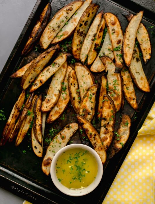 Greek Potatoes are loaded with flavor and made with a delicious sauce that includes garlic, parsley, oregano, lemon, and olive oil. The perfect side dish to make and share with your family. simplylakita.com