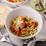 Martha Stewart One-Pan Pasta in white bowl with forks and bread