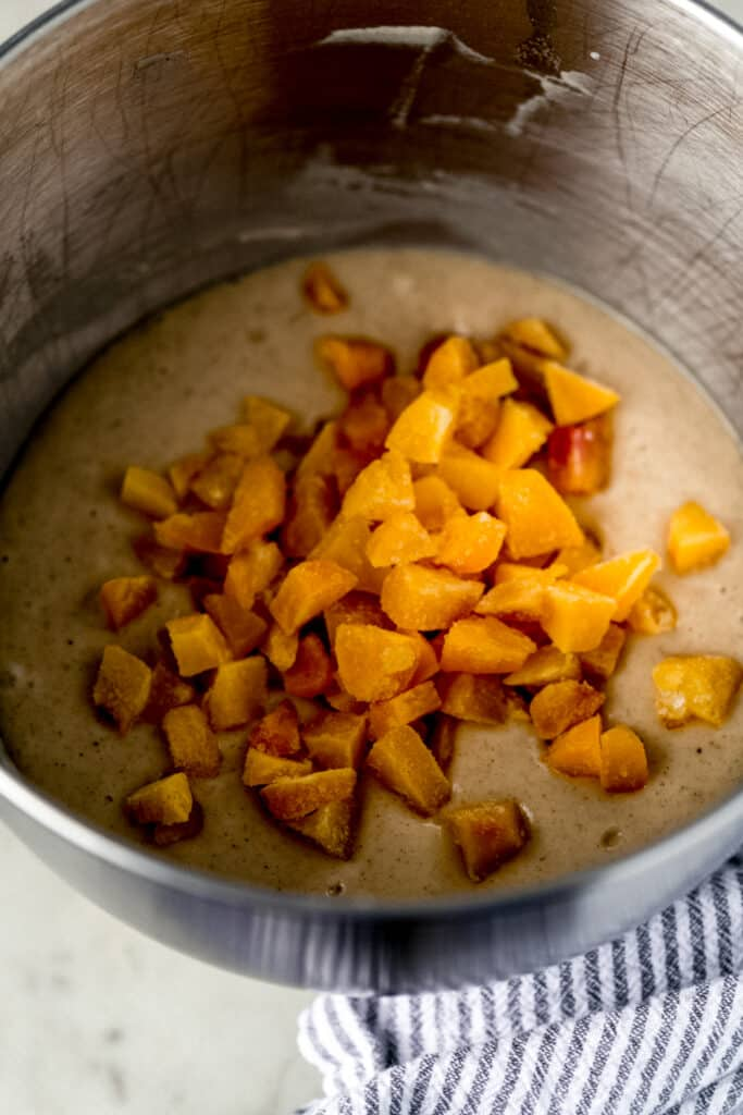 peaches added to mixing bowl with muffin mixture