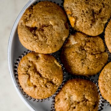 close up view peach cobbler muffins in a large serving bowl