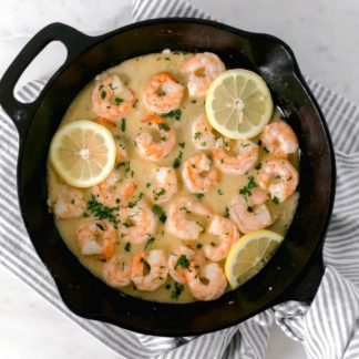 Overhead of Garlic Butter Shrimp in cast iron skillet