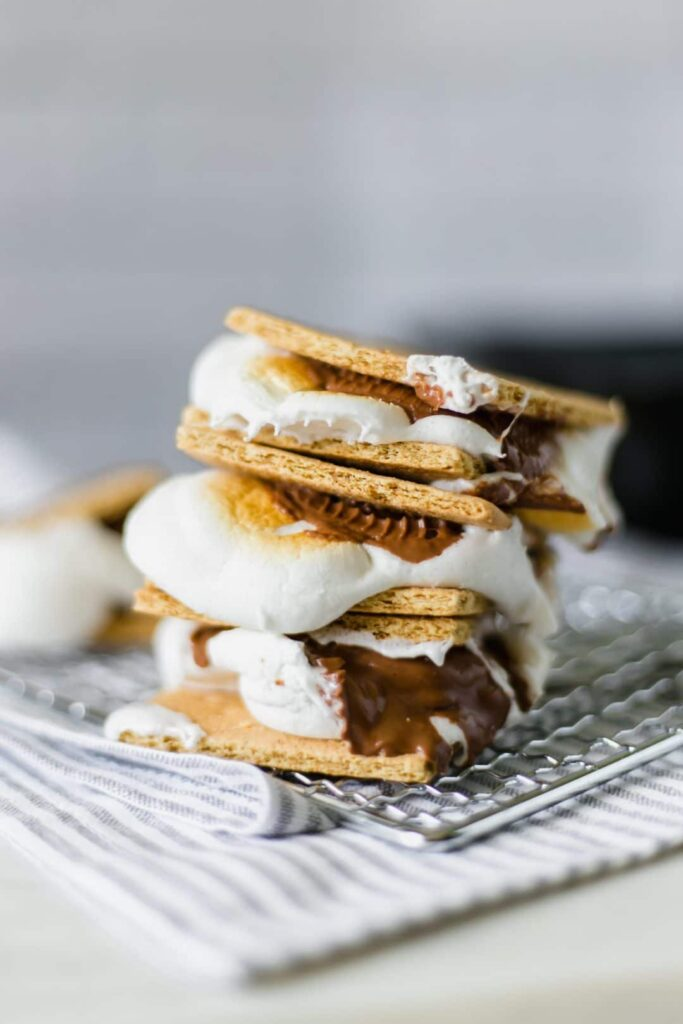 Chocolate Peanut Butter Cup S'mores takes a new spin on a classic treat by adding a delicious peanut butter cup. What can be better than a graham cracker, marshmallow, chocolate, and peanut butter? simplylakita.com #nationalsmoresday #summer #smores