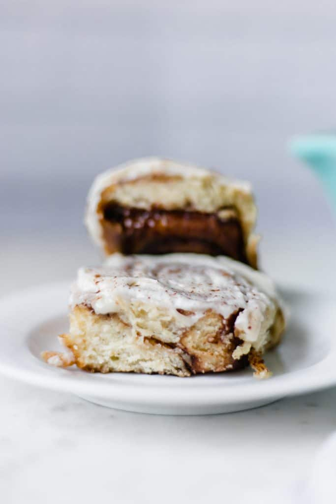 Cinnamon Rolls are sweet, soft, fluffy, and delicious. Loaded with cinnamon flavor and topped with a creamy cream cheese frosting. simplylakita.com #cinnamonrolls #cinnamonrollrecipe #dessert