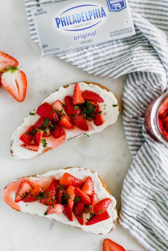 Overhead Strawberry Cream Cheese Toast with napkin and cream cheese