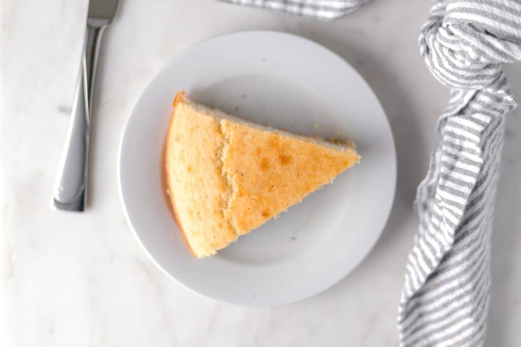 This Southern Cornbread recipe is hot, buttery, and delicious. Made in a cast iron skillet and is perfect with a bowl of chili or in cornbread dressing. simplylakita.com #southerncornbread #easycornbreadrecipe #cornbread