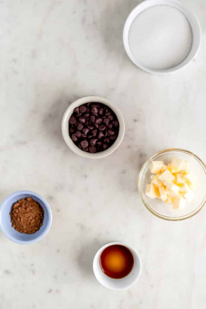 ingredients for brownies in small bowls on marble