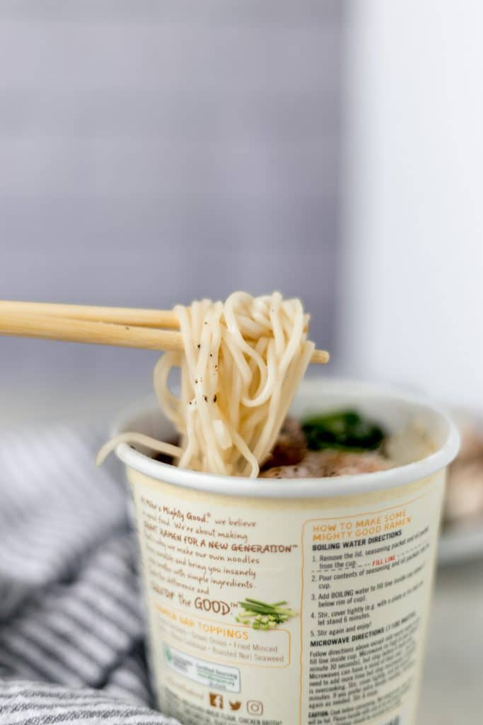 close-up side view instant ramen with chopsticks