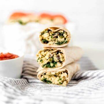 side photo of stacked breakfast burritos recipe