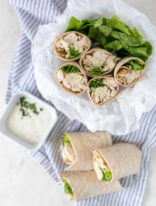 Easy to make Chicken Ranch Wraps are loaded with chicken, cheese, ranch dressing, and lettuce for a delicious lunch option. simplylakita.com #chicken #10minuterecipe