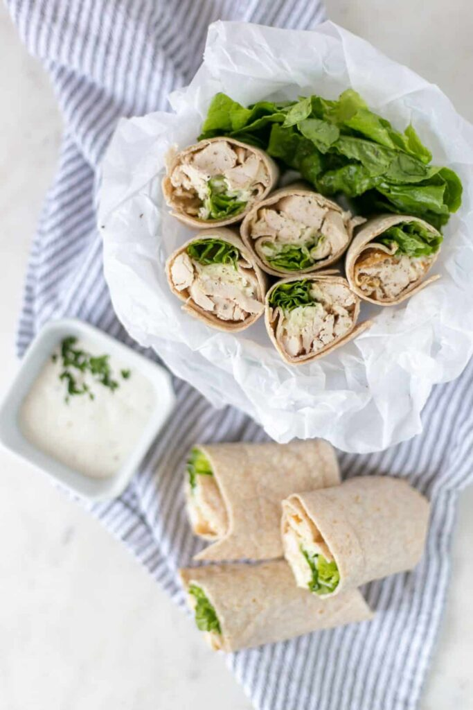 overhead view chicken ranch wraps in bowl with napkin