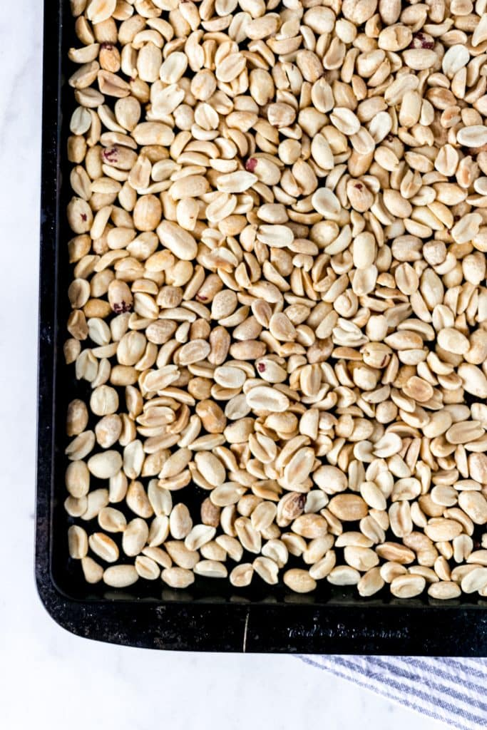 overhead view of roasted peanuts on sheet pan