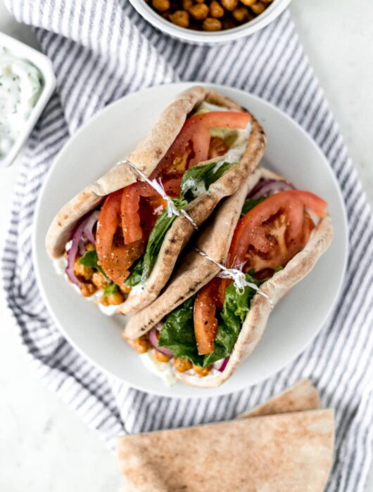 Spicy Chickpea Gyros is a simple and delicious Mediterranean inspired recipe that is full of flavor and contains a tasty tzatziki sauce. simplylakita.com #gyros #vegetarian