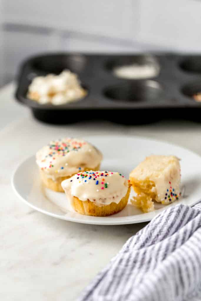 white plate with vanilla cupcakes for two on it
