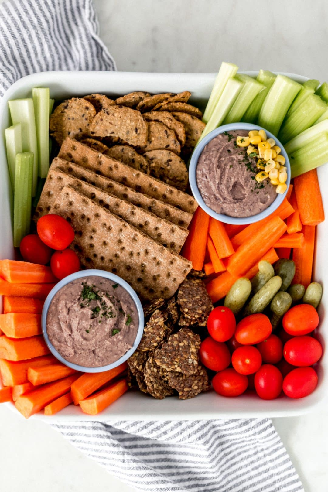 Black Bean Dip is an easy to make healthy recipe that anyone can pull together by adding black beans, spices, olive oil, and lime to a food processor. simplylakita.com #blackbeandip #vegandip