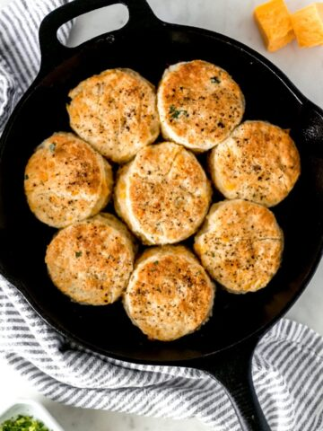overhead view of cheddar biscuits in a cast iron skillet