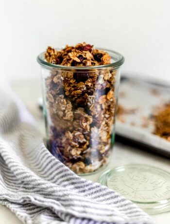 close-up side view of homemade granola in a jar with napkin