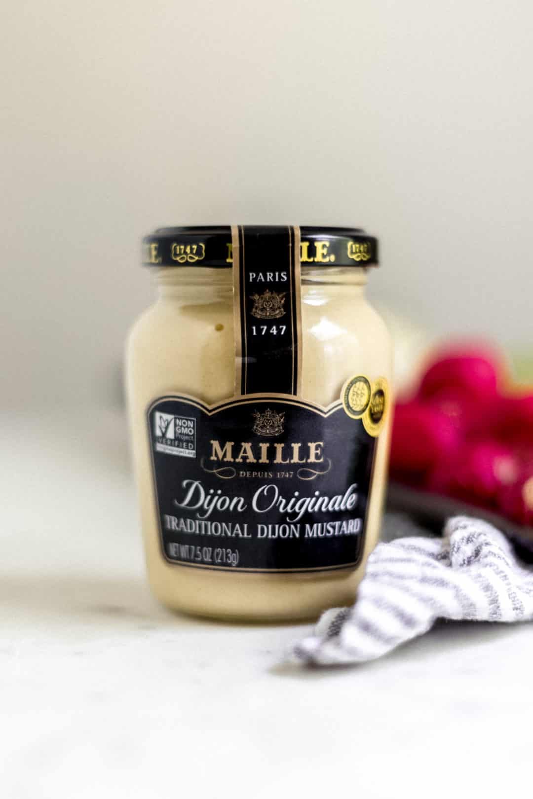 close-up side view of jar of Maille Dijon Mustard