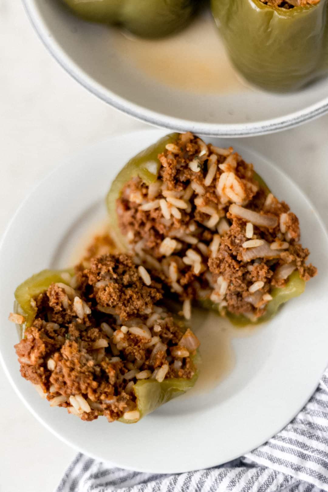 stuffed pepper on a white plate cut in half