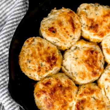 cheddar and herb biscuits in cast iron skillet